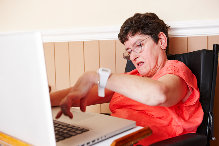 Disabled woman using a computer.